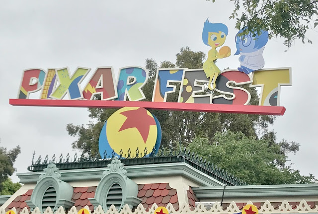 Colorful Pixar Fest sign at Disneyland.